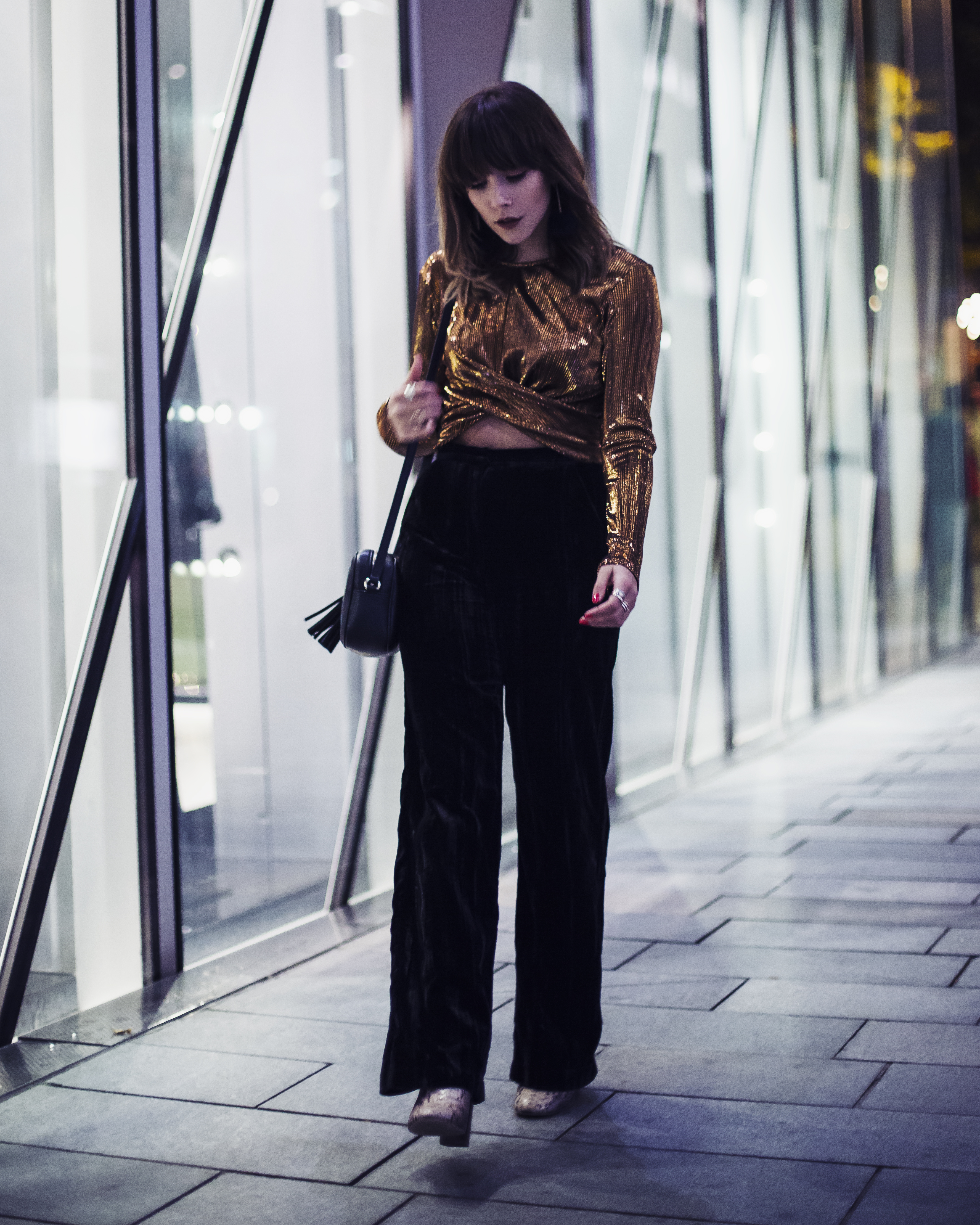 MEGAN ELLABY WEARS METALLIC TOP AND VELVET WIDE LEG TROUSERS AT PARTY SEASON